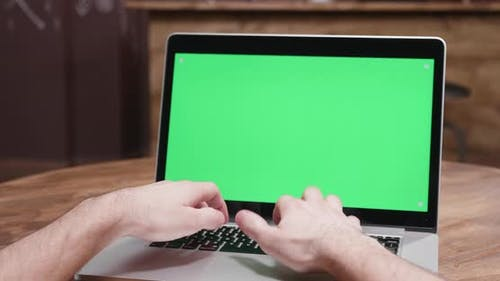 POV Parallax Footage of Male Hands Typing Fast on a Computer with Green Screen
