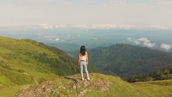 Thumbnail for Attractive Girl Smiles In Scenic Nature. Aerial Static