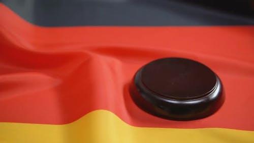Gavel Striking on Sound Block Against German Flag, National Legal System, Law