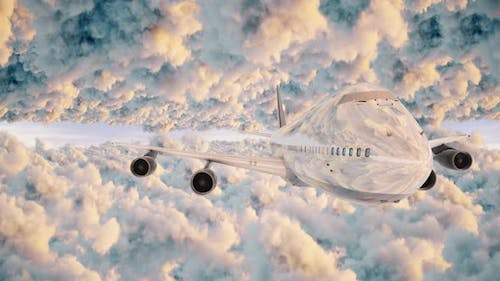 Airplane Front View Fyling Between Puffy Clouds Sunlight