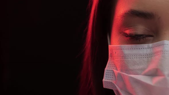 Young Woman Put on Medical Mask in Studio
