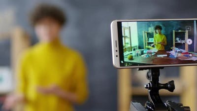 Female Vlogger Recording Video on Smartphone