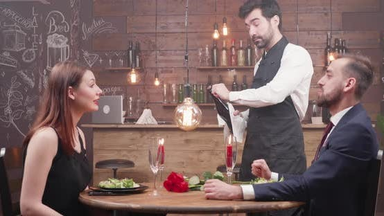 Thumbnail for Bartender Opening a Bottle of Champagne in Front of a Couple