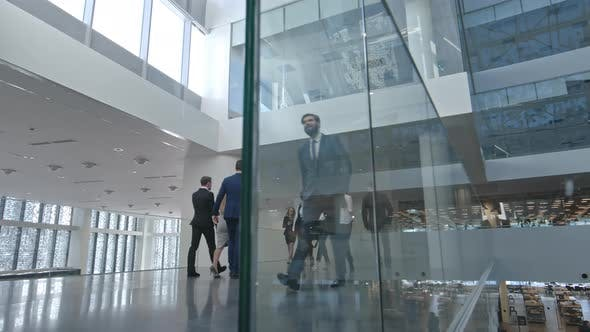 Businesspeople Walking in Business center
