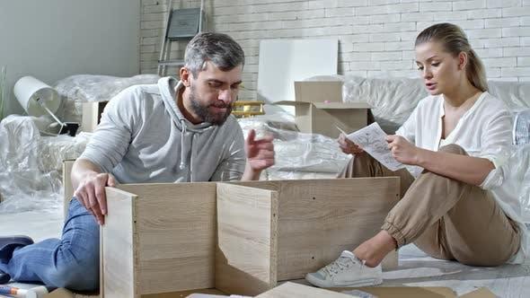 Thumbnail for Man and Woman Assembling Shelf
