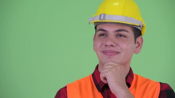 Cover Image for Face of Happy Young Multi Ethnic Man Construction Worker Thinking and Looking Up