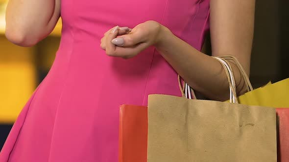 Thumbnail for Woman with Shopping Bags on Arm Talking Over Mobile Phone, Shopaholic, Close-Up