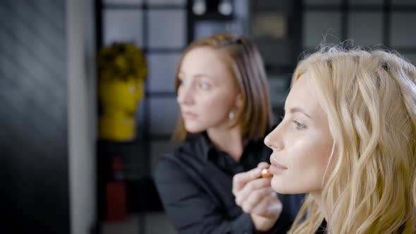 Thumbnail for Master of Makeup Is Applying Powder on Face Skin of Beautiful Blonde Client Woman in Beauty Shop