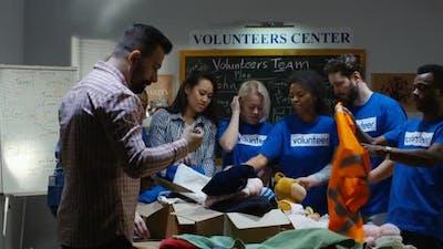 Medium Shot of a Volunteer Team at Work