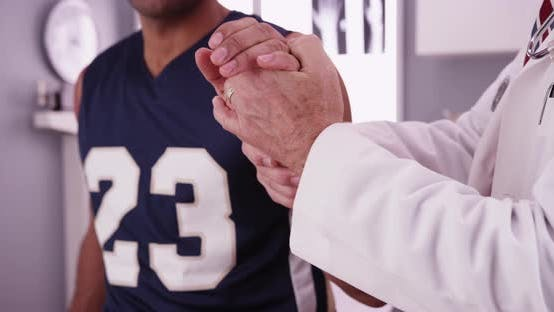 Thumbnail for College basketball player with sports injury being examined by doctor