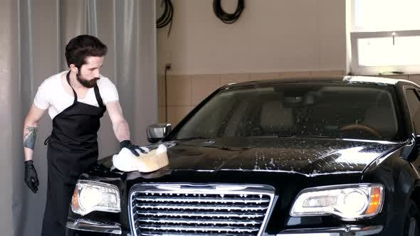 Cover Image for Man Washing His Car in a Garage