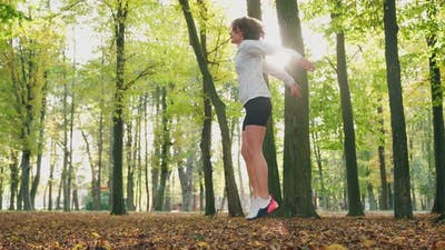 Fitness Woman Jumping at Park