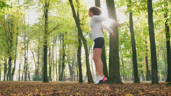 Fitness Woman Jumping at Park