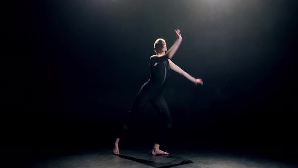 Thumbnail for Elegant Dancer in Black Performing Modern Dance