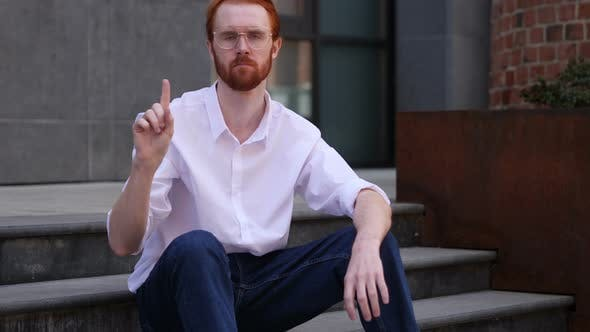 Thumbnail for Designer Sitting on Office Stairs Rejecting Offer by Waving Finger