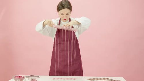 Pretty Female Chocolatier Making Hand-crafted Ruby Chocolate Candies
