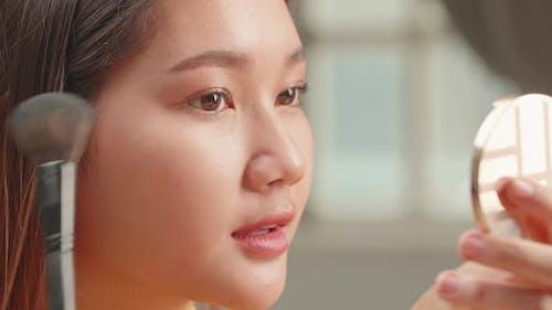 Close Up Asian Girl Makeup With Cosmetic Powder Brush