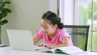 A girl studying online distance learning while quarantine at home.
