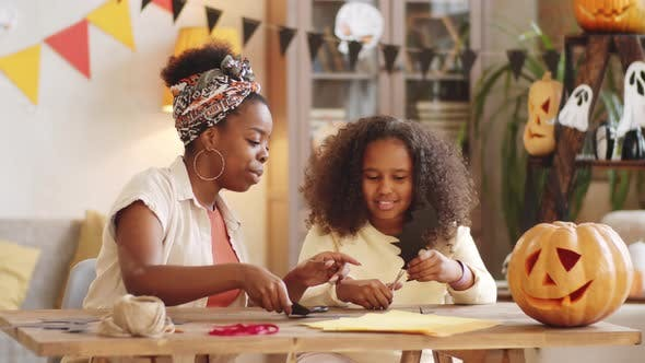 Thumbnail for Happy Black Mother and Daughter Making Paper Bats for Halloween