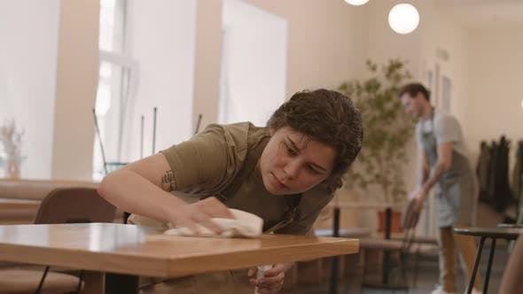 Thumbnail for Female Cafe Worker Wiping Table Scrupulously
