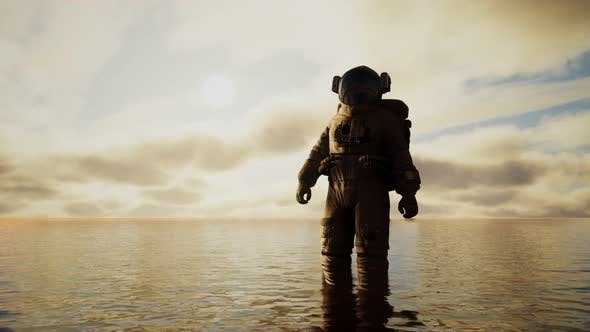 Thumbnail for Spaceman in the Sea Under Clouds at Sunset