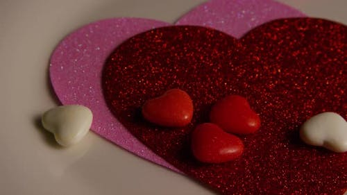 Rotating stock footage shot of Valentines decorations and candies - VALENTINES 0099