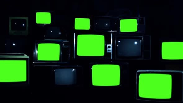 Thumbnail for Wall of Old TVs turning on Green Screens. Dark Tone.