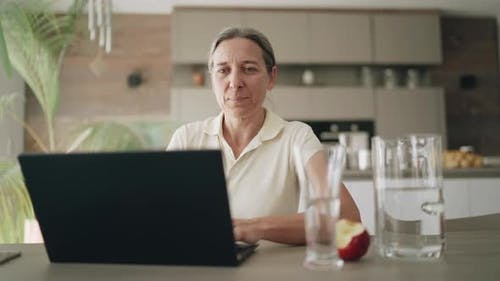Video Woman Working at Home at Laptop During Covid-19 Curfew