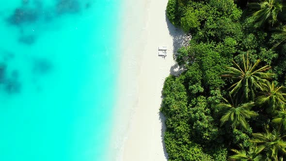 Thumbnail for Wide birds eye abstract shot of a white sandy paradise beach and turquoise sea background in colorfu
