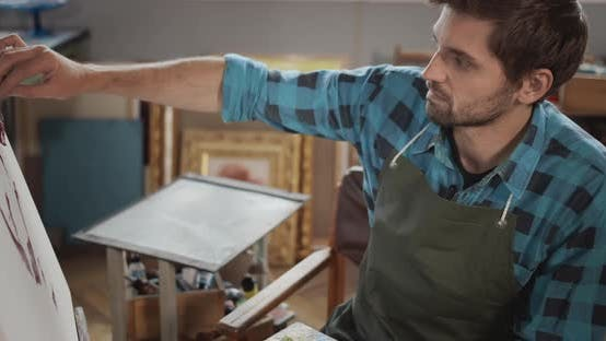 Thumbnail for Artist Painting on Molbert Closeup