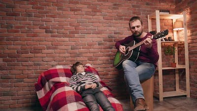 Father Playing Guitar with His Son