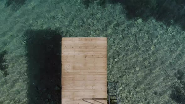 Thumbnail for Aerial view of a wooden deck in the mediterranean sea.