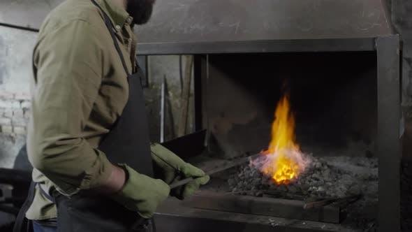 Thumbnail for Blacksmith Forging Billet in Stove