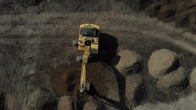 The work of the excavator. Digger from the air.