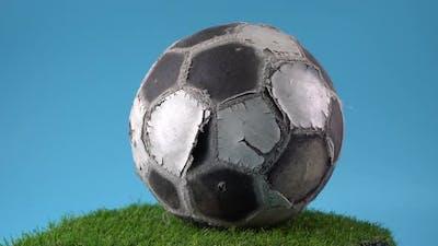 Damaged football rotated on the turntable
