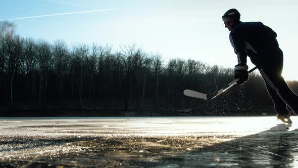 Thumbnail for Hockey Player on Frozen Lake Make Ice Sparkles on High Speed Braking.hockey Stick in Hands, Canadian