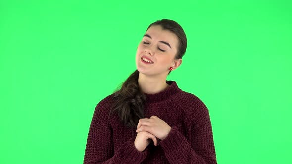 Thumbnail for Lovely Girl Daydreaming and Smiling Looking Up. Green Screen