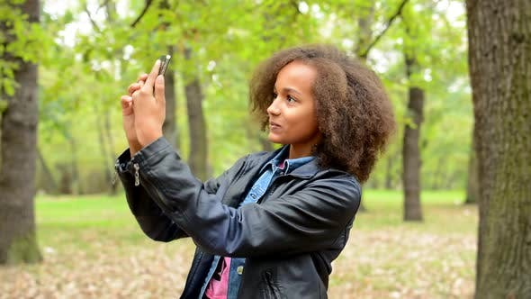 Thumbnail for Young Beautiful Happy Girl Make Selfie with Smartphone in the Park