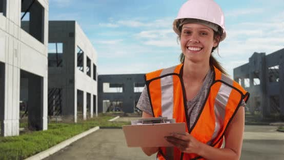 Thumbnail for Portrait of happy woman construction worker smiling at camera