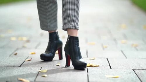 Elegant Female Leather Shoes on Slender Legs, Closeup View of Stepping Feet on Tiled Ground
