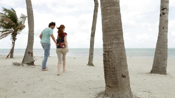 Thumbnail for Young couple running on beach