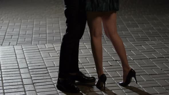 Cover Image for Loving Couple Hugging and Kissing in Night Street View of Legs Relationship