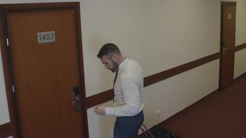 Businessman Check into Hotel Room