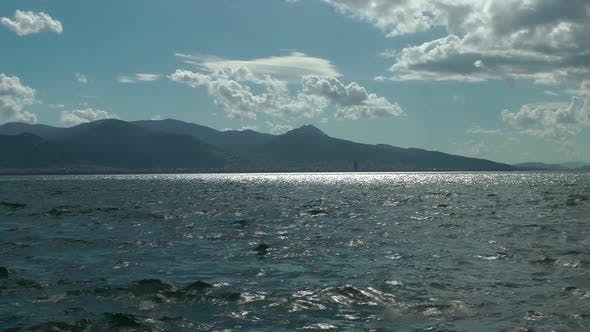 Thumbnail for Blue Spring Clouds And Seascape With Mountains