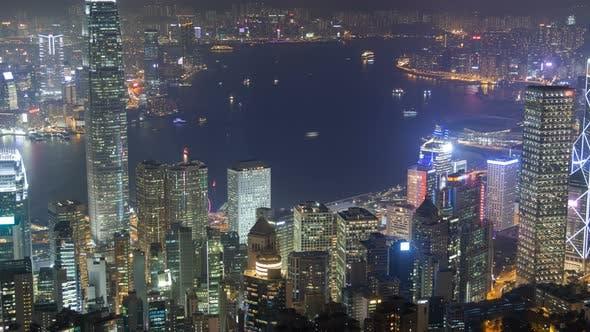 Hong Kong Skyline Urban Panorama at Night Time Lapse China. Zoom Out