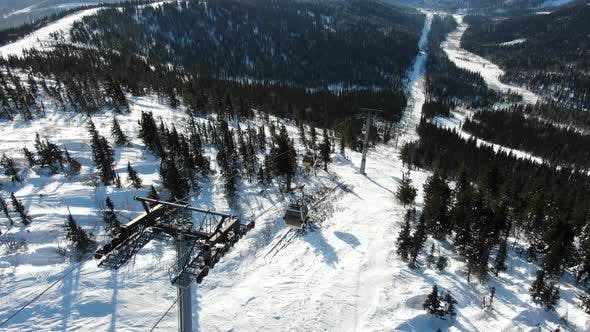 Thumbnail for Modern Ski Lifts Lift People Up the Mountain in a Tourist Resort Aerial View