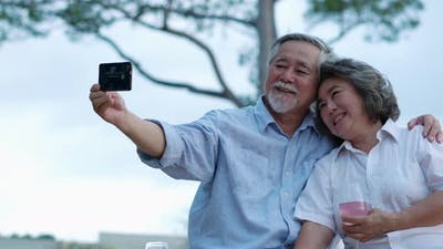 Couple senior selfie with smartphone