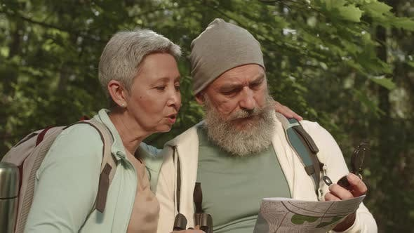 Two Active Elderly People Planning Their Route