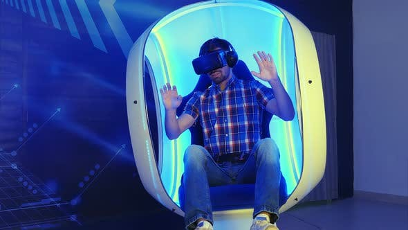 Thumbnail for Young Man Playing Videogame in 3D Virtual Reality Simulator