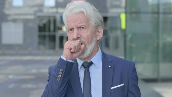 Outdoor Coughing Old Businessman